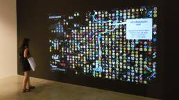 Visitor interacting with a real time map of emojis and tweets of Prague at Big Bang Data Prague at DOX by Tekja