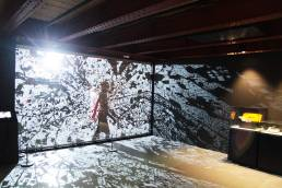 A person walking in an immersive installation by Tekja at the Science and Industry Museum in Manchester