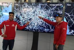 MotoGP riders point at the 'Tale of Three Cities' exhibit by Tekja for Octo Telematics at Silvestone
