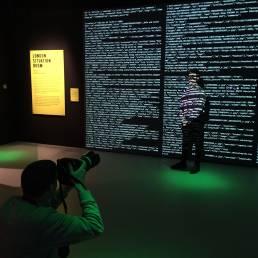 London Data Streams Tekja data visualisation a man stands awash with data